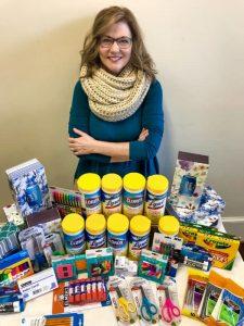 Jennifer Erwin with school supplies.