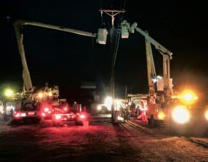 Little River lineworkers with bucket trucks restoring power after dark