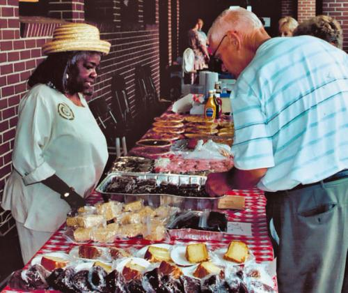 Homemade desserts are pictured being sold and served at a past annual meeting.