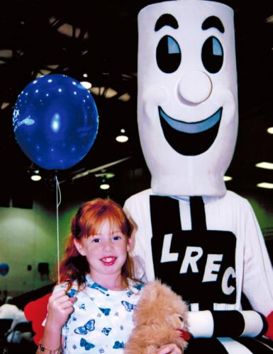 One of our youngest members is pictured with the LRECI costumed mascot at an annual meeting.